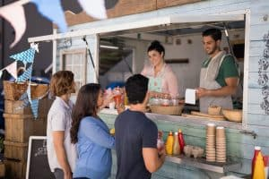 people ordering from a food truck