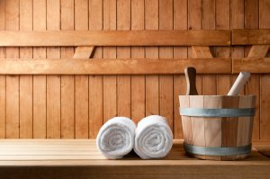bucket and white towels in a sauna
